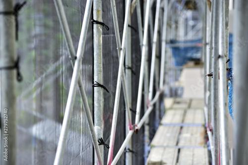 Fototapeta Scaffold of construction site. Apartment repair work.