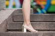 female legs in beige high-heeled shoes