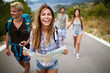 canvas print picture - Adventure, travel, tourism and people concept - group of smiling friends with backpacks and map