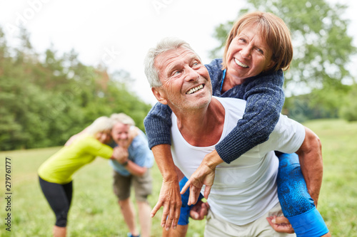 Stampa su Tela  Happy seniors have fun in nature