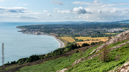 Fototapeta Summer coastal landscape as seen from the Bray Head Cliff Walk offering stunning views over the Irish Sea and the lovely countryside in Ireland on a sunny day