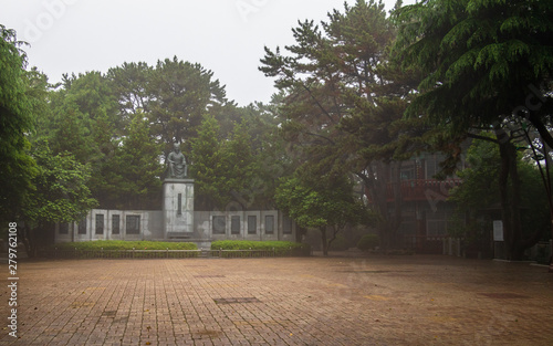 Valokuva  Central Square with Statue of Choe Chiwon and Pavilion in Dongbaek Park on a foggy day