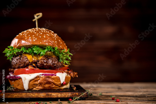 Fototapeta Close-up of home made tasty burger on wooden table. obraz