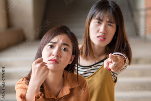 portrait of two angry asian women Wallpaper Mural