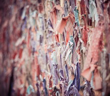 Multicolor Cloth Scraps Hanging On Fence