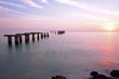 canvas print picture - Boca Grande Florida sunset at old pier abutments in water