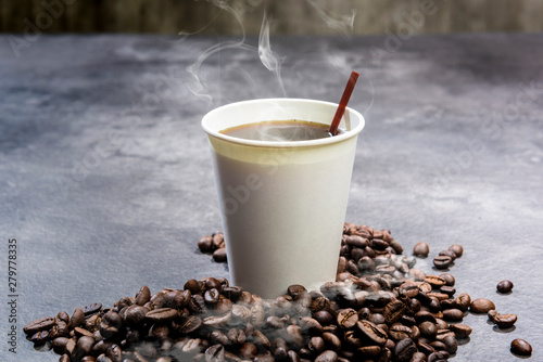 Photo sur Toile Cafe Styrofoam cup with hot coffee and coffee beans