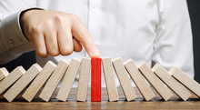 Businessman Stops Collapse Domino Effect. Stress Resistance Business. Financial Stability. Recovery Business. Evaluation Of Cash Risks. Creating A Strategy. Management And Planning. Decision Making