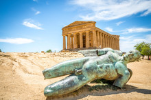 Icarus Bronze Statue And Temple Of Concordia In The Valley Of Temples - Agrigento, Sicily, Italy.