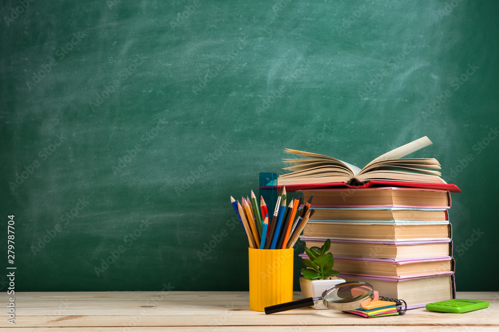 Fototapety, obrazy: Education and reading concept - group of colorful books on the wooden table in the classroom, blackboard background