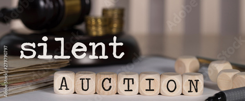 Photo Words SILENT AUCTION composed of wooden dices.