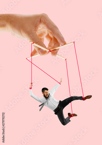Stampa su Tela Man like a puppet in somebodies hands on coral background