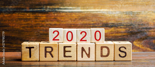 Fototapeta Wooden blocks with the word Trends 2020. Main trend of changing something. Popular and relevant topics. New ideological trends of fashion. Recent and latest trend. Evaluation methods. Fashionable obraz