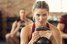 Determined Fitness Woman Doing Squat With Kettle Bell