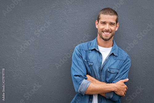 Obraz Handsome young man smiling - fototapety do salonu
