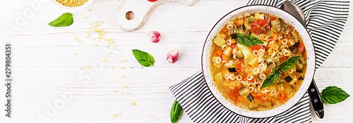 Obraz na płótnie Minestrone, italian vegetable soup with pasta on white table