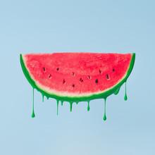Watermelon Melting On Sky Blue Background. Summer Food Minimal Concept.