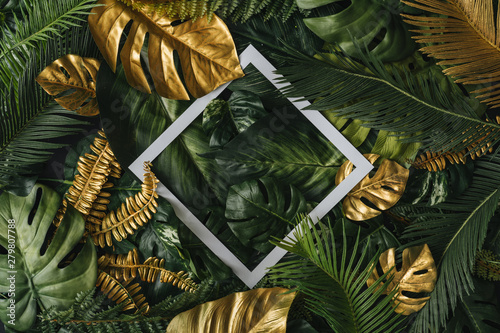 Tuinposter Palm boom Creative nature background. Gold and green tropical palm leaves. Minimal summer abstract jungle or forest pattern. White paper frame copy space.