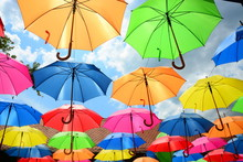Colorful Umbrellas On The Background Of Blue Sky