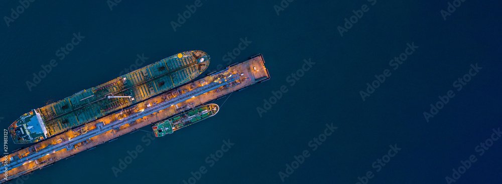 Fototapety, obrazy: Aerial view tanker ship loading in port at night, Tanker ship logistic import export business and transportation, with copy space.