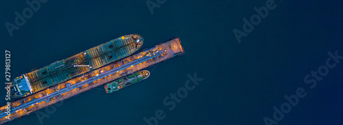 Fototapeta Aerial view tanker ship loading in port at night, Tanker ship logistic import export business and transportation, with copy space. obraz