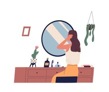 Young Woman Sitting At Dressing Table And Primping Her Hair. Cute Girl Making Hairstyle In Front Of Mirror. Morning Routine, Start Of Working Day, Everyday Life. Flat Cartoon Vector Illustration.