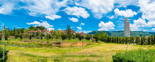 Türaufkleber Himmelblau Panorama beautiful romantic of Venetian-style Italian village landscape on mountain with blue sky and cloud background in Thailand. Timelapse
