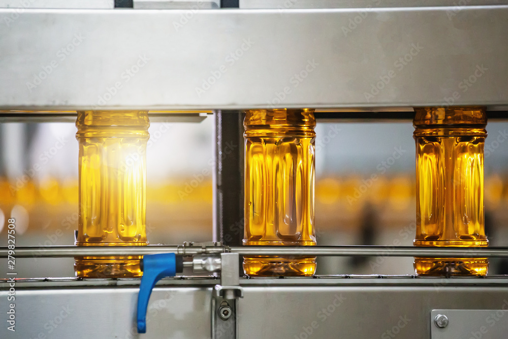 Fototapety, obrazy: Bottles with fresh organic juice or sunflower oil on automatic conveyor belt in factory interior inside with modern industrial machine equipment