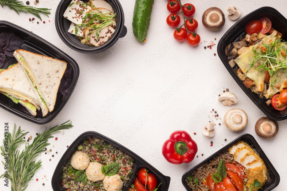 Healthy food delivery in black boxes with tasty meal on white