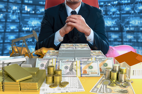 Fototapeta Businessman sitting with investing instrument  obraz