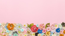 Lots Of Colorful Homemade Paper Flowers On Pink Background At The Bottom. Top View