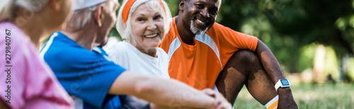 Obraz panoramic shot of cheerful multicultural men and women in sportswear - fototapety do salonu