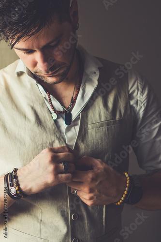 Cuadros en Lienzo  Cool elegant casual man with bracelets, rings and pearcings