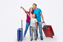Family Of Travelers Pointing Away