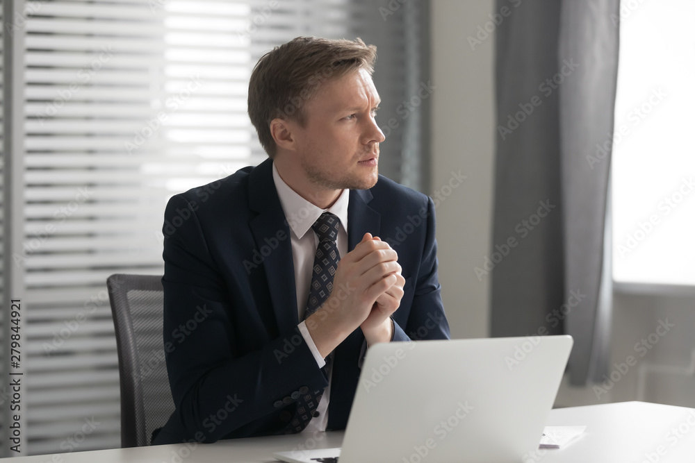 Fototapeta Serious thoughtful businessman feel doubtful concerned about business challenge