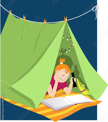 Little girl reading with a flashlight in a blanket fort, shadow shows pirate shi Fototapeta