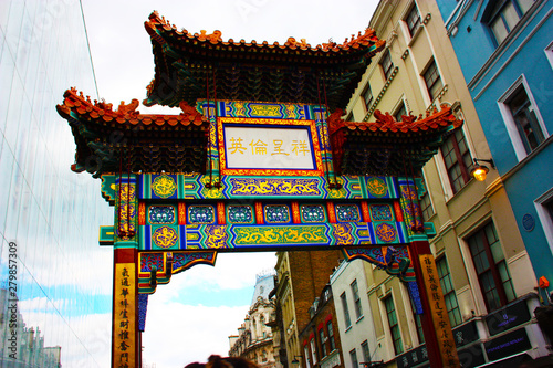 The colorful arch of entry to Chinatown in London, in the typical picturesque neighborhood