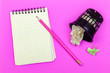 canvas print picture - Notepad, pink pencil, paper basket with crumpled paper sheets and on a corrugated pink surface.