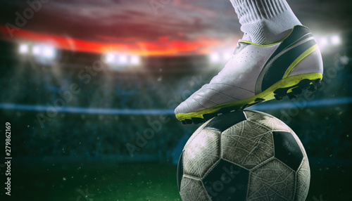 close-up-of-a-soccer-striker-ready-to-kicks-the-ball-at-the-stadium