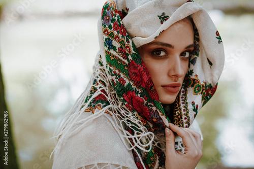 Valokuvatapetti Portrait of a beautiful girl in a Ukrainian embroidered dress