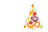 Fototapeta Fototapety do kuchni - Christmas tree made of pieces of vegetables and fruits on a white background. The concept of vegan and vegetarian food. Top view, flat lay, copy space. Creative layout.