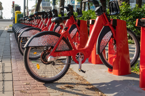 Fototapety, obrazy: public electric bikes parked on the street