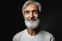 Studio Portrait Of Handsome Senior Man With Gray Beard.