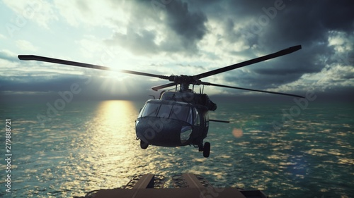Fotografía  Military helicopter Blackhawk lands on an aircraft carrier in the endless blue ocean