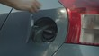 Close up of woman closing car gas tank fuel door, 4k
