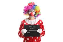 Sad Clown Posing With A Jail B...