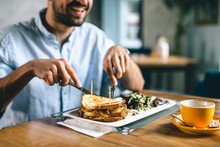 Closeup Of Man Eating Dinner Or Breakfast In Restaurant
