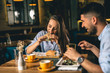 canvas print picture - A happy young couple having dinner or breakfast at a fancy restaurant