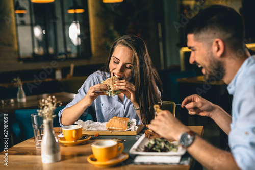 Canvas Print A happy young couple having dinner or breakfast at a fancy restaurant