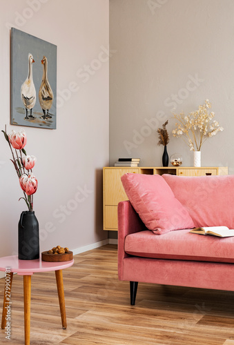 Cuadros en Lienzo Flowers in vases on wooden commode in contemporary living room interior with pas